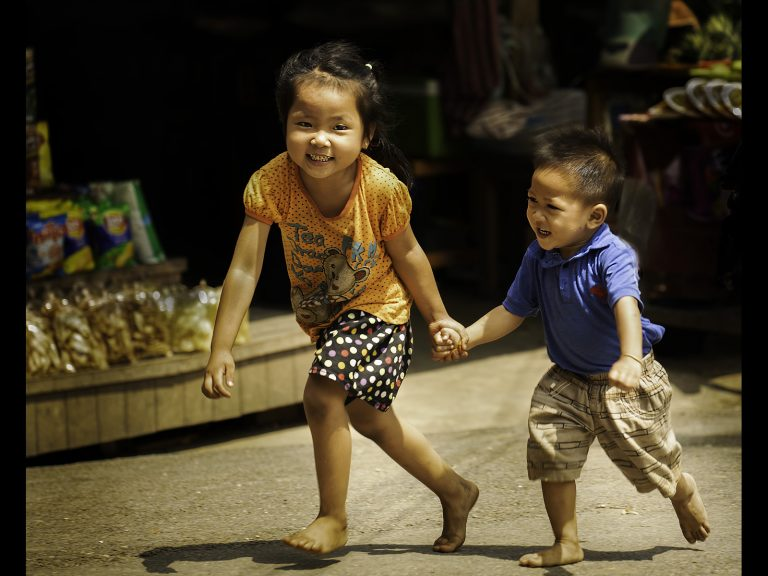 Print Commended_Two Laotian children having fun by Ken Brown